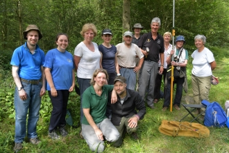 Roving volunteers in woodland by Brian Taylor