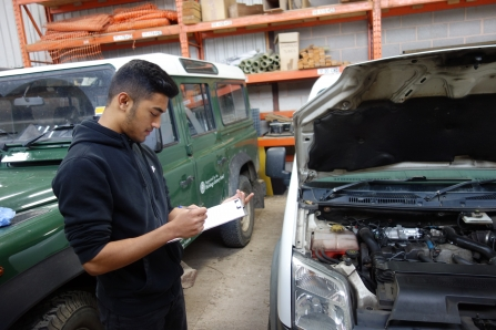 Work experience teenager checking vehicles by Ben Rees